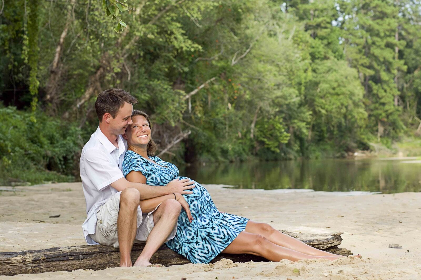 Huntsville TX expecting mother and husband in a creek
